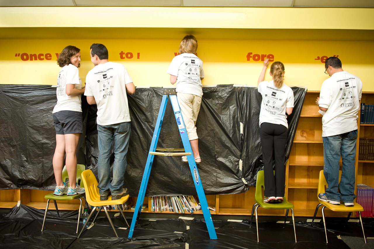 Volunteers create a wall mural in the library of West Education Campus, a K - 8 public school in Washington, DC. The volunteers were at the school as part of a September 11th National Day of Service and Remembrance event organized by HandsOn Greater DC Cares and U.S. Vets -- United States Veterans Initiative. The event was attended by over 200 White House and Corporation for National and Community Staff and their families. (Corporation photo by Sam Kittner, 2011)
