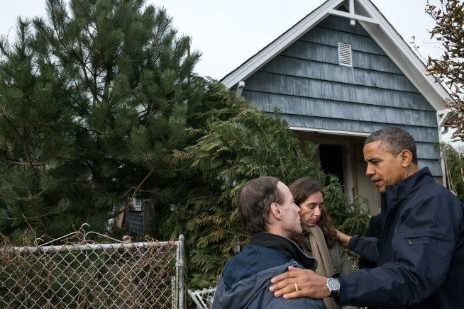 President Barack Obama talks with residents on Cedar Grove Avenue during a walking tour of Hurricane Sandy storm damage in Staten Island, NY, Nov. 15, 2012. (Official White House Photo by Pete Souza)