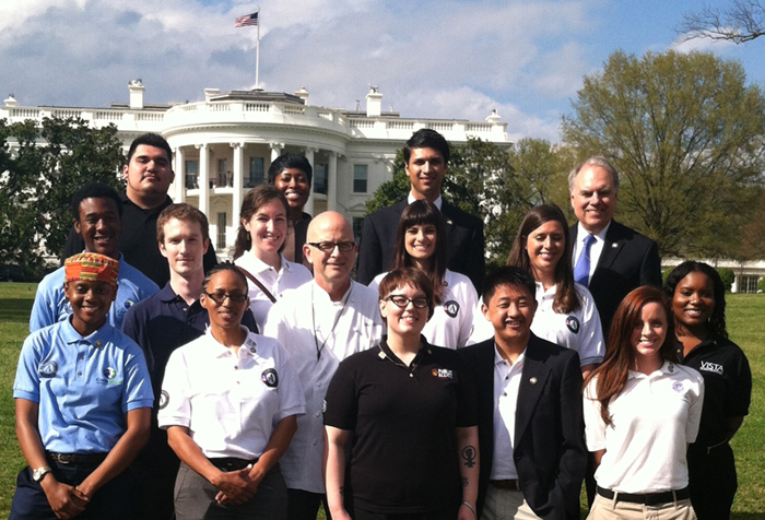 On Friday, April 12, 12 AmeriCorps members gathered outside the White House before meeting with President Obama and other White House officials. Front row, from left: Myeasha Taylor; Regina Best; Meghan Dillie; Teng Yang; Jamie Casterton; Kela Harris. Second row: Leonard Chase; Tyler Anger; Stephanie D'Esposito; Ashlyn Ramos; Amy DeLair. Back row: Ernesto Morales; Laysha Ward, Chair, Corporation for National and Community Service Board of Directors; Asim Mishra, Chief of Staff, CNCS; Bill Basl, Director, AmeriCorps.