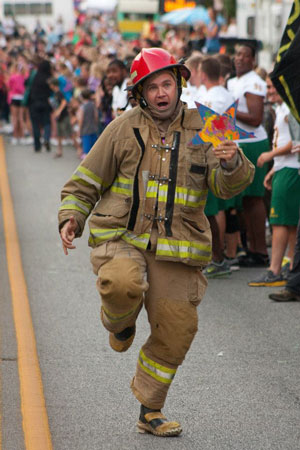 Ryan Stanley, representing the business sector, races toward the finish line in the first Joplin on fire for Service race to raise awareness about service in honor of 9/11.  He carries a Star of Hope like those taken to Minot, ND, for the National Day of Service and Rememberance disaster recovery project.