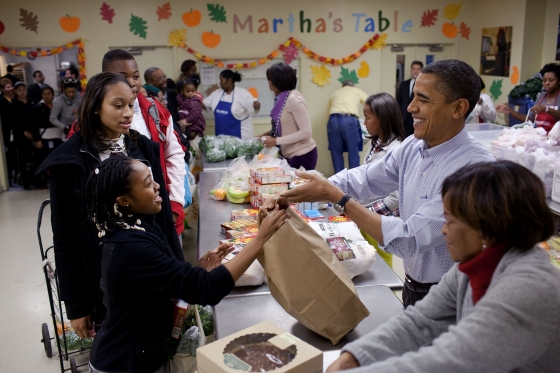 President Barack Obama, First Lady Michelle Obama, daughters Sasha and Malia, and mother-in-law Marian Robinson help distribute Thanksgiving food items at Martha's Table, a food pantry in Washington, D.C., Nov. 24, 2010. (Official White House Photo by Pete Souza)