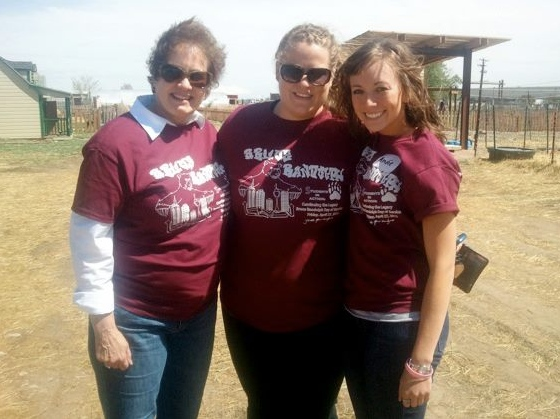 Rachel Ogorek, center, poses with two friends during a break at a project site. Rachel completed her AmeriCorps term in August 2012.