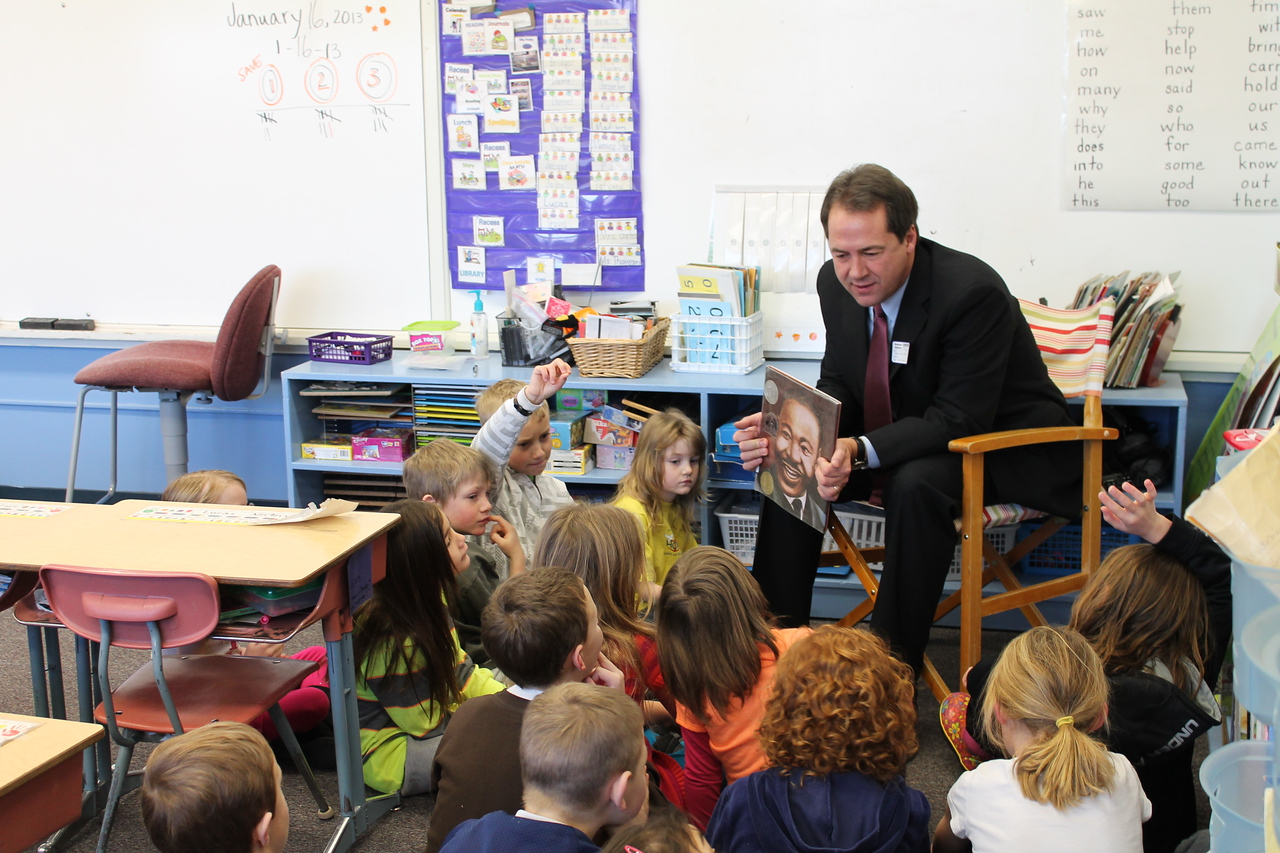 Montana Gov. Steve Bullock reads to a school classroom during Martin Luther King Day festivities.