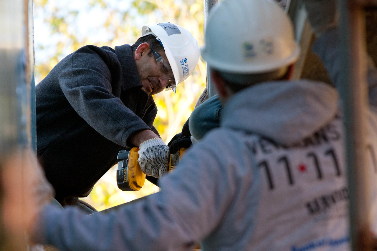 Veterans participate in a Habitat for Humanity home build with Mission Serve on Veterans Day 2011.