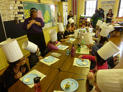 Students at Chicago's Mark Sheridan Math & Science Academy sampled—and enjoyed—nutritious food prepared by Chef Lovely Jackson as part of a Chefs Move to Schools event on April 5th.