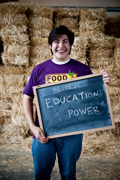An AmeriCorps member with Food Corps displays a personal belief statement about why he became involved with Food Corps. (Photo by Whitney Kidder, PaperMoon Photography, 2011)