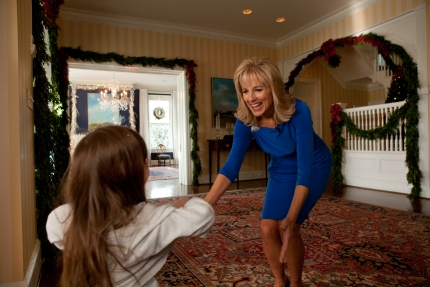Dr. Jill Biden greets a student arriving at the Vice President's Residence for a holiday party