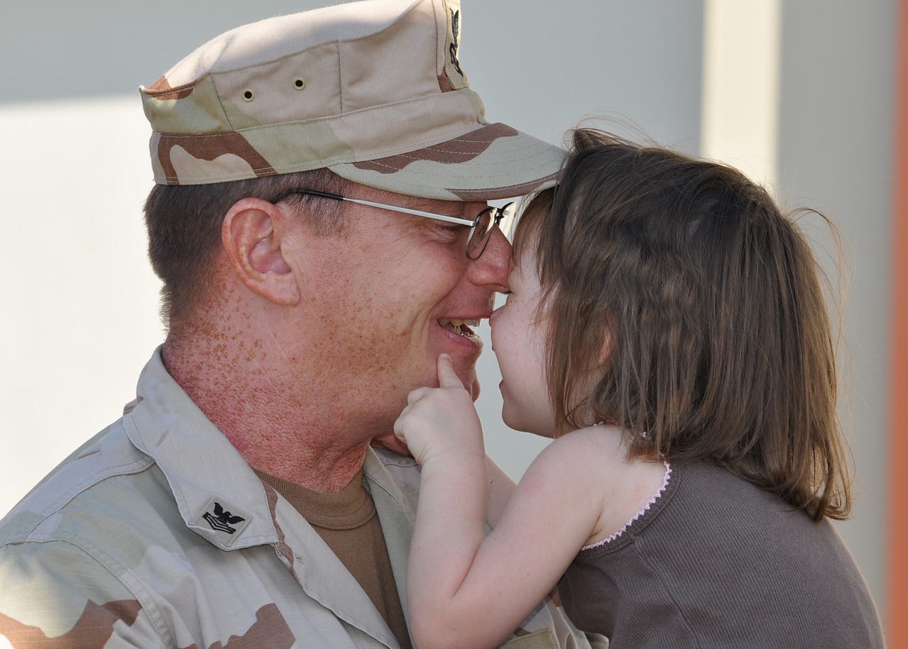 100918-N-7361H-073 <br /> TAMPA, Fla. (Sept. 18, 2010) Builder 1st Class Barry Rivernider, assigned to the reserve component of U.S. Naval Forces Central Command, attends the Pre-Deployment Family Readiness Conference with his daughter at the Navy Operational Support Center Tampa at MacDill Air Force Base. The event was designed to educate families about the support services available to assist them before, during and after a deployment. (U.S. Navy photo by Mass Communication Specialist 2nd Class Jennifer P. Harman/Released)