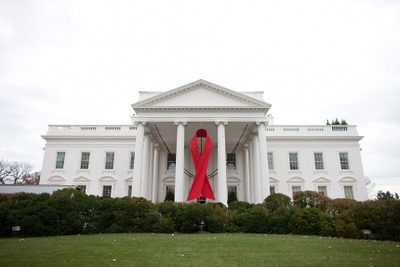 A red ribbon is displayed on the North Portico of the White House, Nov. 30, 2010, in advance of World AIDS Day. (Official White House Photo by Lawrence Jackson)