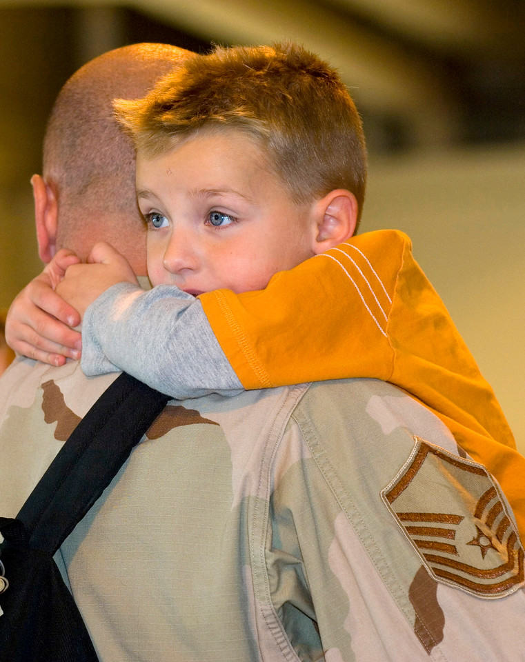 ELMENDORF AIR FORCE BASE. Alaska- Dekota hugs his father Master Sergeant Noah Wood who just arrived home from being deployed. 40 deployed airmen assigned to Air Expeditionary Force 1 were greeted by friends, family and coworkers at the joint military complex on Elmendorf Air Force Base, Alaska. (U.S. Air Force photo/Senior Airman Garrett Hothan)