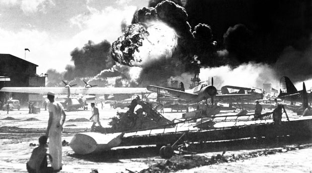 Captured Japanese photograph taken during the attack on Pearl Harbor, December 7, 1941.  In the distance, the smoke rises from Hickam Field.  (Navy) NARA FILE #:  080-G-19948 WAR & CONFLICT BOOK #:  1134