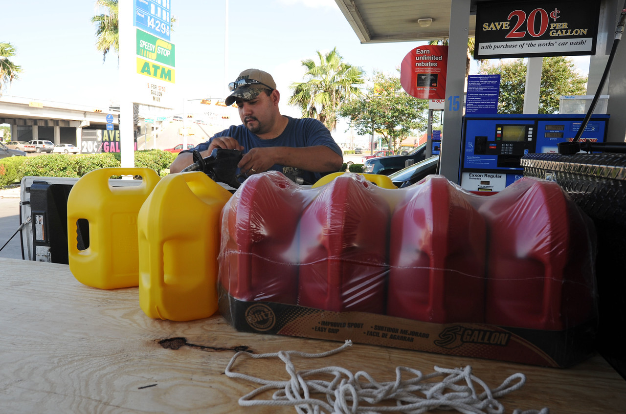 James Alverez fills up extra tanks with gas in preparation for Hurricane Ike in Corpus Christi, TX on September 10, 2008. (Photo by Jocelyn Augustino/FEMA)