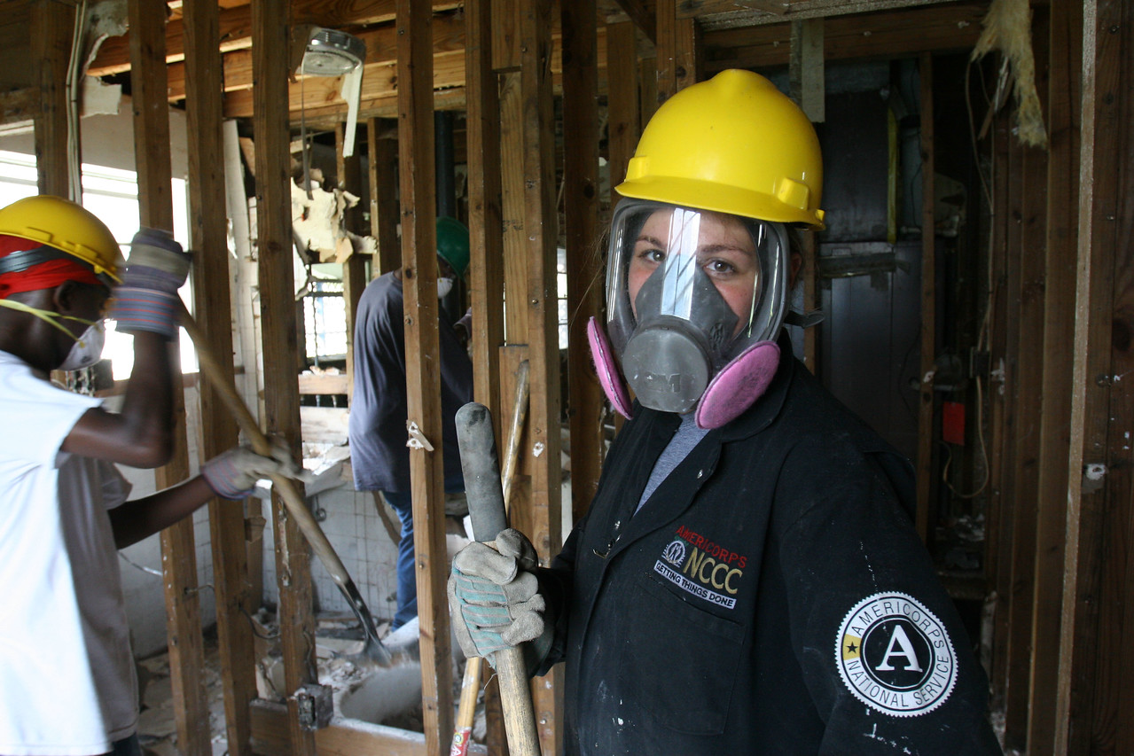 An AmeriCorps*NCCC member inside a house damaged by Hurricane Katrina in St. Bernard Parish, LA.  More than 35,000 national service participants contributed more than 1.6 million hours of volunteer service during the first year of hurricane relief and recovery efforts along the Gulf Coast, according to a report released on August 25, 2006 by the Corporation for National and Community Service.
