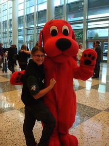AmeriCorps NCCC alum and Congressional Gold Medal Award winner, Cassie Holtz, poses with Clifford the Big Red Dog at the 2009 National Conference on Volunteering and Service in San Francisco, CA.