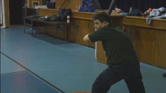 A Rockaway Special Athlete gets ready for a pitch during an indoor Wiffle ball game.