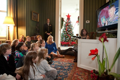 Students listen to Major James Blain – the father of Jimmy Blain – read Mickey's Christmas Carol.