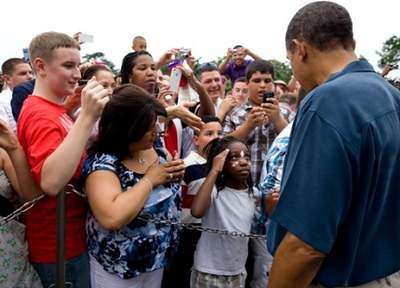 A young girl salutes President Barack Obama as he shakes hands along a ropeline with members of the military and their families at the White House, July 4, 2011.