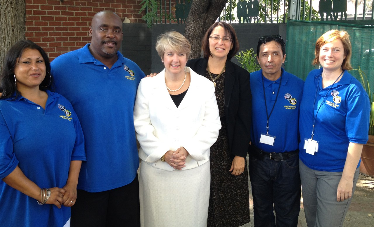 Corporation for National and Community Service CEO Wendy Spencer (center left) and California Secretary of Service and Volunteering Karen Baker (center right) meet with the staff of Hope for the Homeless in Los Angeles, CA.