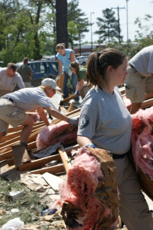 NCCC Corps Members remove debris from a resident's home in Leakesville, MS