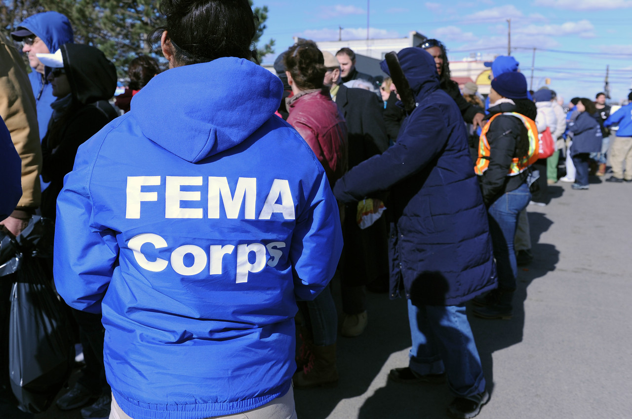 FEMA Corps members talk to Rockaway, NY, residents waiting in line to visit the Disaster Recovery Center on Nov. 3, 2012, after being impacted by Hurricane Sandy. (Photo by Jocelyn Augustino/FEMA)