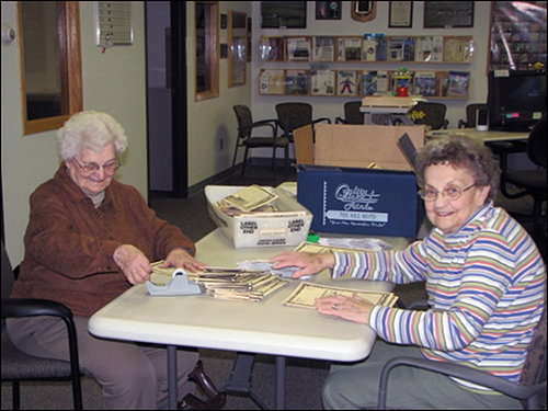 Earth Team Volunteers Lyla Schulz and Jean Herauf (L to R) prepare a conservation mailing to famers in the Dickinson, N.D., NRCS office.
