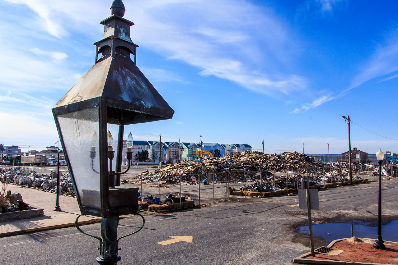 The residents of Long Beach Island have worked aggressively to remove debris in this New Jersey community. The piles of debris have been collected and separated for recycling in an effort to recover from Superstorm Sandy. (FEMA photo by Steve Zumwalt)