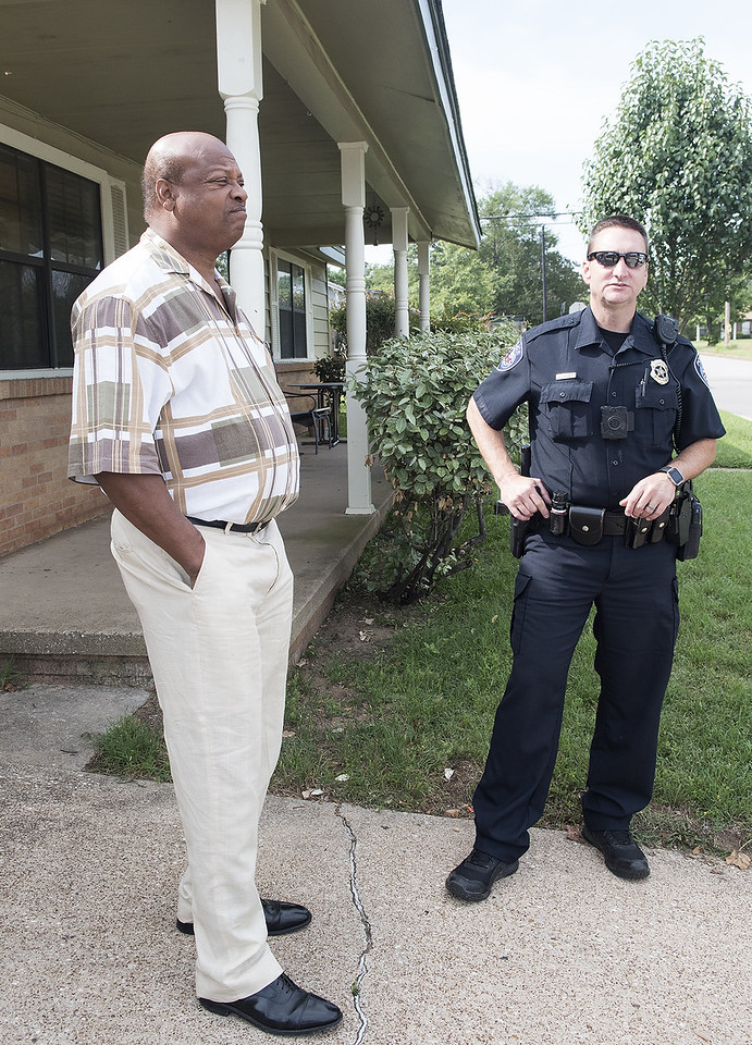 Tyler Police Officer Darrell Gardner meets with Butler College neighborhood resident Donald Sanders during his beat Tuesday morning May 30, 2017.  (Sarah A. Miller/Tyler Morning Telegraph)