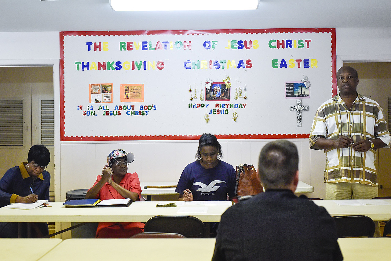 Donald Sanders, far right, speaks to Officer Darrell Gardner, second from right, as Dianne Dewberry, left, Josephine Hayden, second from left, and Cassandra Johnson, center, listen during a community meeting at St. James Missionary Church in Tyler, Texas, on Tuesday, May 30, 2017. Gardner has worked the same beat for over 18 years. He has established a relationship with the citizens who call him directly when things are not right in their neighborhoods. (Chelsea Purgahn/Tyler Morning Telegraph)