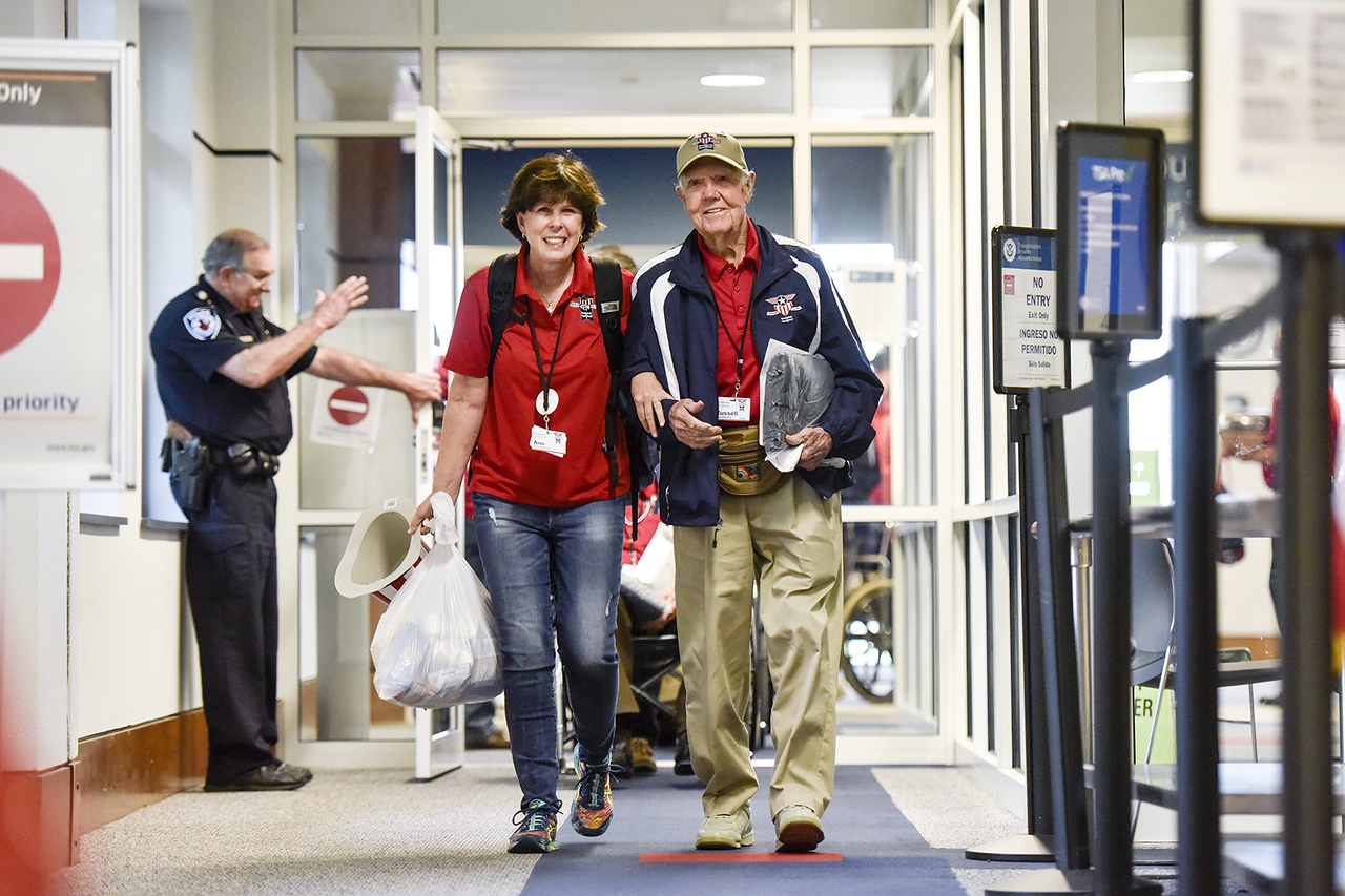 Ann Brookshire walks with Russell VanMatre as the walk into the airport during a welcome home celebration for the Brookshire's Heroes Flight at Tyler Pounds Regional Airport in Tyler, Texas, on Wednesday, May 31, 2017. The veterans left for Washington, D.C., Monday morning to visit memorials and the Capitol, and returned home Wednesday evening. Chelsea Purgahn/Tyler Morning Telegraph)