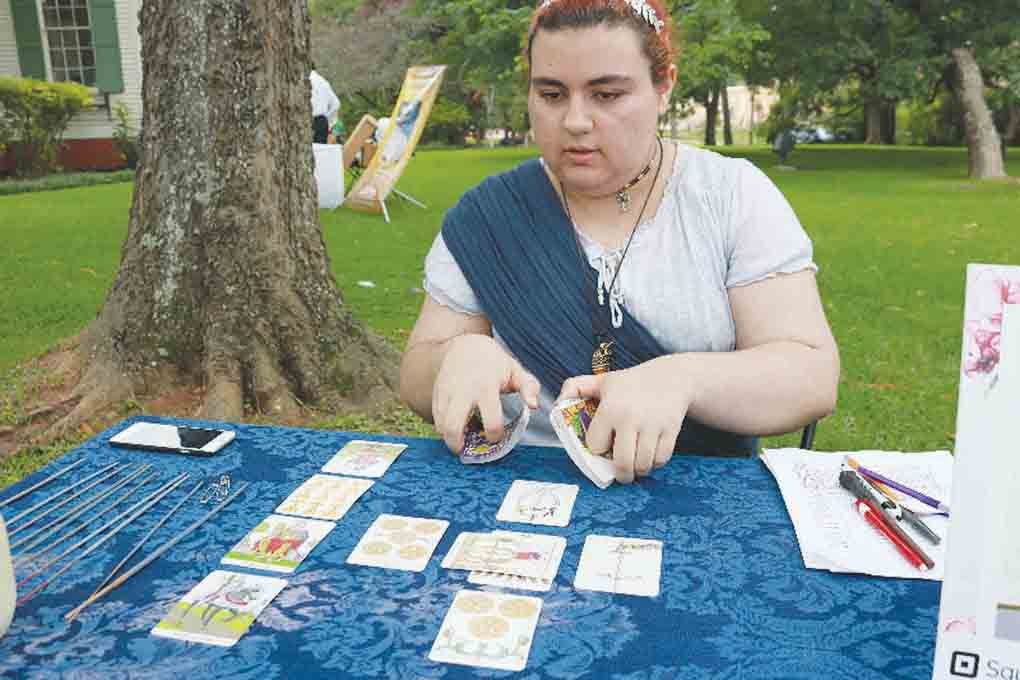 Alex Jones, 16, shuffles Tarot cards in preparation for a reading during the second annual Tyler Celtic Festival on the grounds of the Goodman-LeGrand House & Museum on Saturday. (Schuyler Wick/Staff)