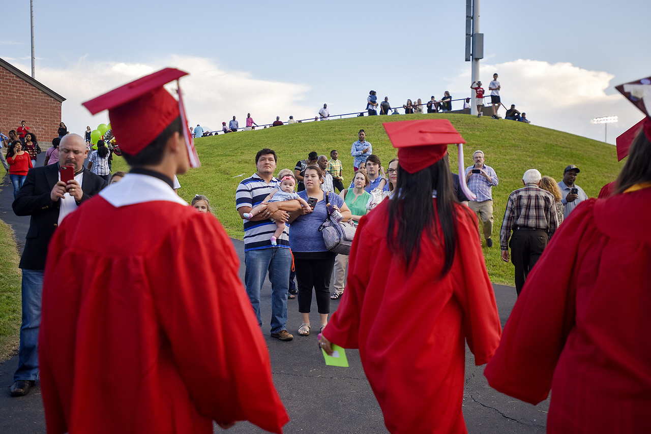 Family and friends watch as seniors walk in during Robert E. Lee High School's graduation ceremony at Trinity Mother Frances Rose Stadium in Tyler, Texas, on Friday, June 2, 2017. Thousands of friends and family members came to see the hundreds of seniors walk the stage for graduation. (Chelsea Purgahn/Tyler Morning Telegraph)
