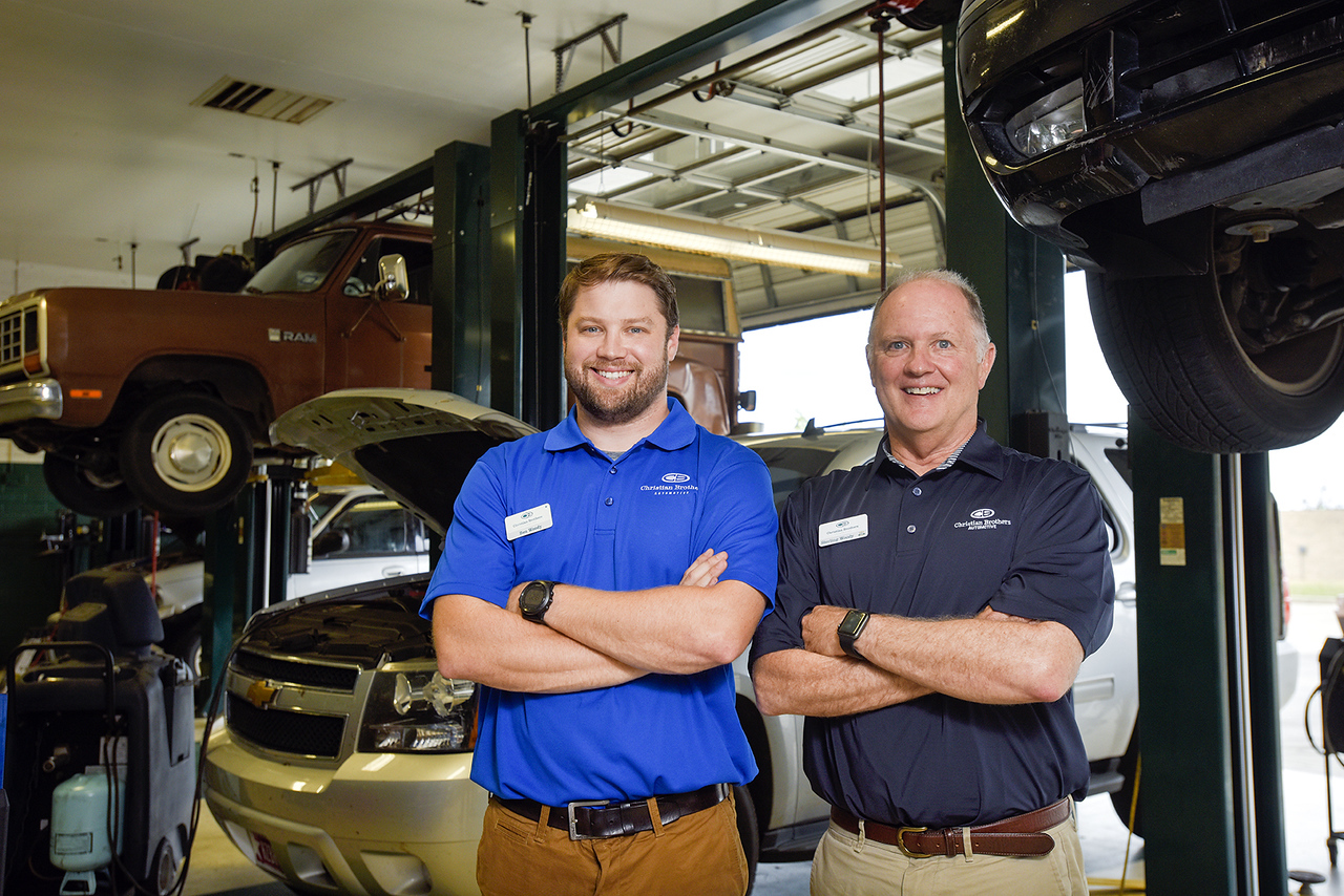 Ben and Sterling Woody pose for a portrait at Christian Brothers Automotive in Tyler, Texas, on Wednesday, May 17, 2017. The father and son operate the franchise together after Sterling acquired the location at the beginning of May. (Chelsea Purgahn/Tyler Morning Telegraph)
