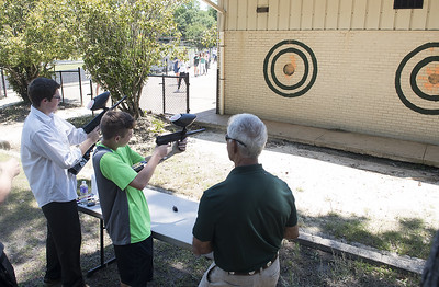 Students shoot paint guns at the field house which will be torn down for the new Brodnax Family Crusader Center at Bishop Thomas K. Gorman Cathedral School Thursday May 25, 2017. The 4.9 million dollar multi-purpose building will replace the existing field house. It will house locker rooms, a weight room, an area for drill, dance and cheer teams and to view films.   (Sarah A. Miller/Tyler Morning Telegraph)