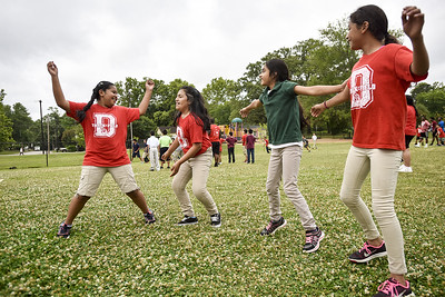 Girls dance during Sports Day hosted by Robert E. Lee students at Douglas Elementary School in Tyler, Texas, on Friday, May 19, 2017. The event was organized in part by teacher Mrs. Jones and her son Royland Black as a way to motivate and reward students for their hard work at the end of the school year. (Chelsea Purgahn/Tyler Morning Telegraph)