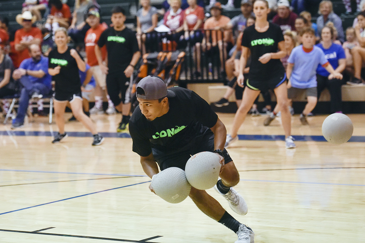 Jorge Sanchez picks up two balls during the third annual dodgeball challenge at John Alexander Gym in Jacksonville, Texas, on Monday, June 5, 2017. The dodgeball game kicked off a week of events for the Jacksonville Tomato Festival. (Chelsea Purgahn/Tyler Morning Telegraph)