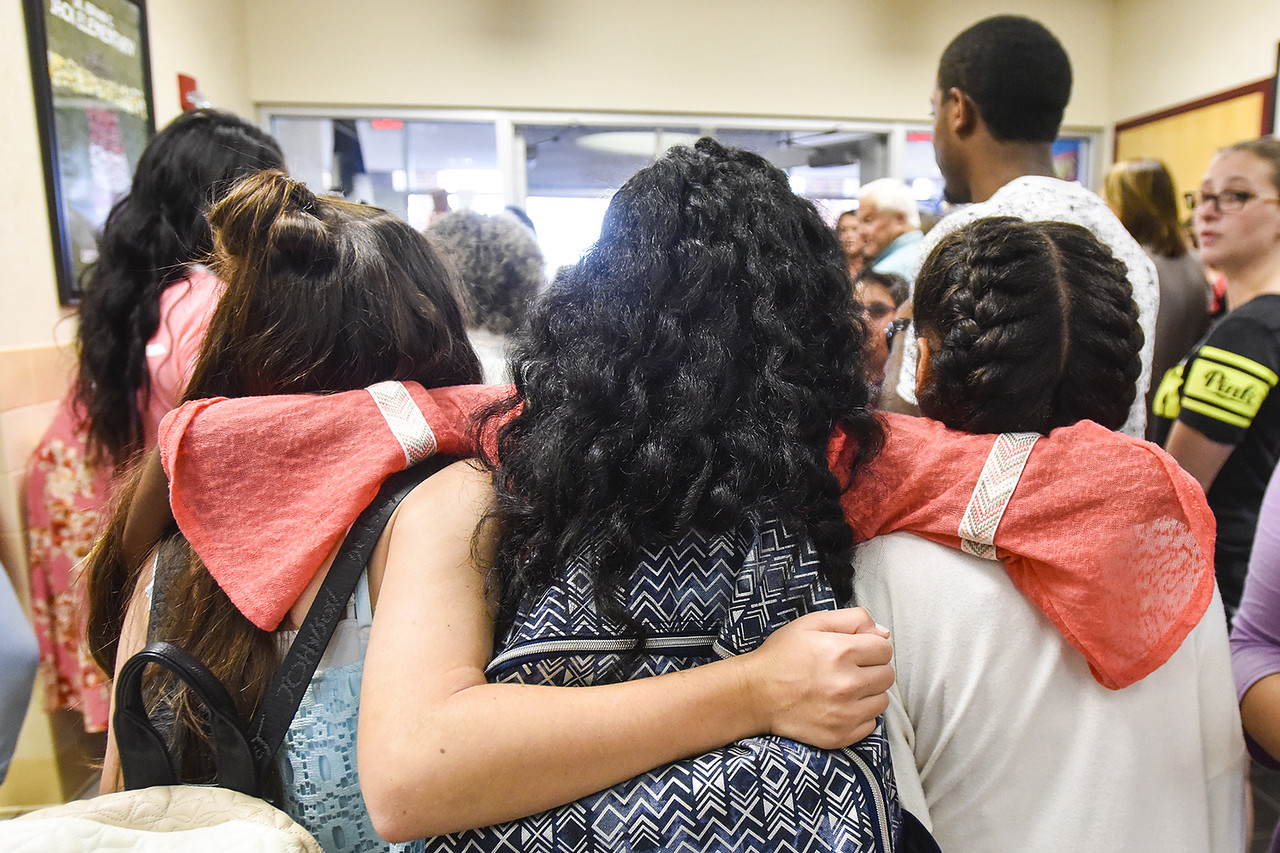 Fifth graders embrace as they leave the building during a sendoff for fifth graders at Jack Elementary School in Tyler, Texas, on Friday, June 2, 2017. The school has hosted the special sendoff for the fifth graders on the last day of school every year since it opened its doors in 2007. (Chelsea Purgahn/Tyler Morning Telegraph)