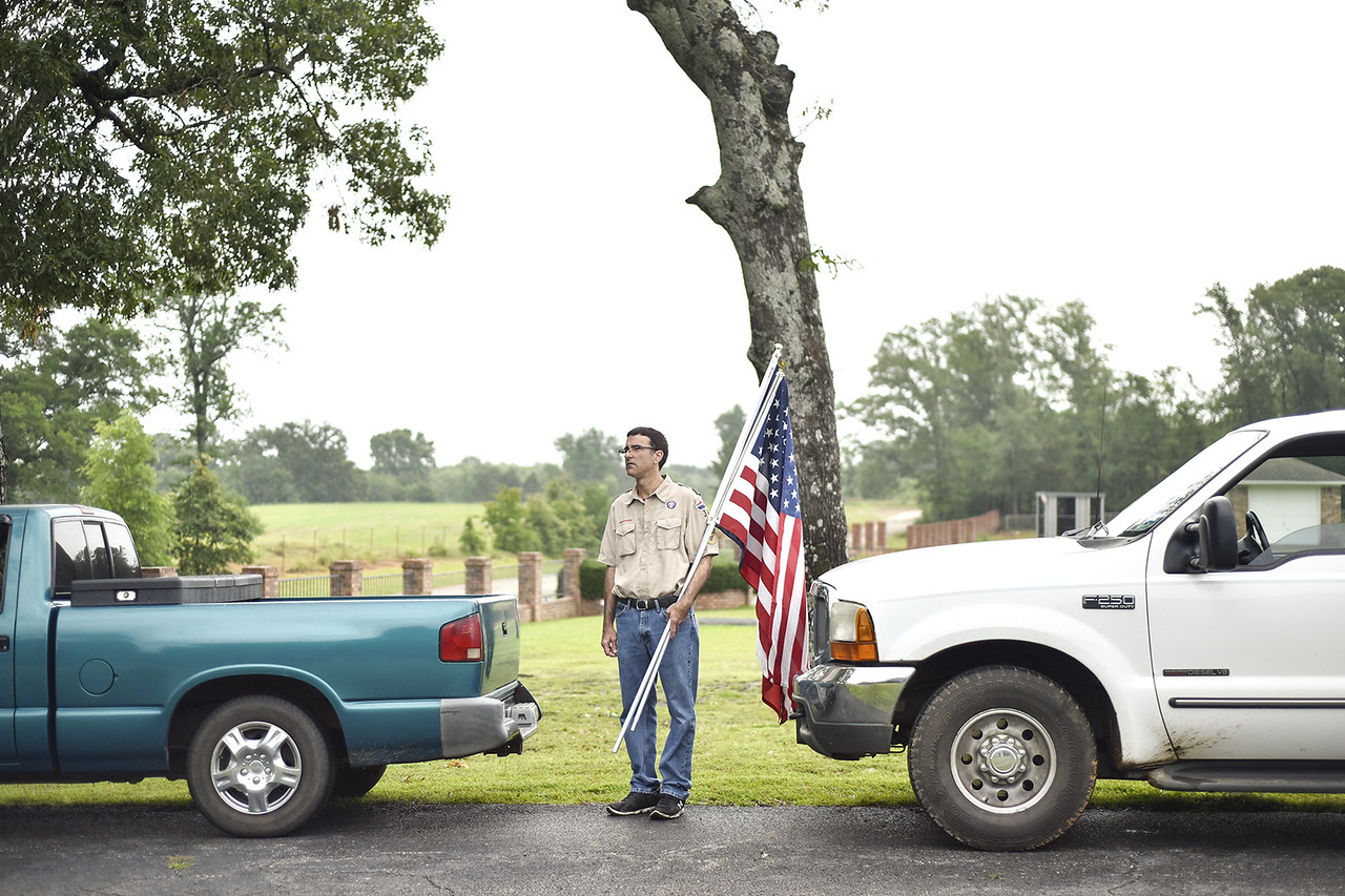 Matt Goodson with Boy Scout Troop 342 watches his troop raise flags during the annual Memorial Day flag ceremony at Chandler Memorial Cemetery in Chandler, Texas, on Monday, May 29, 2017. Names of World War I veterans who rest in the cemetery were read and honored. (Chelsea Purgahn/Tyler Morning Telegraph)