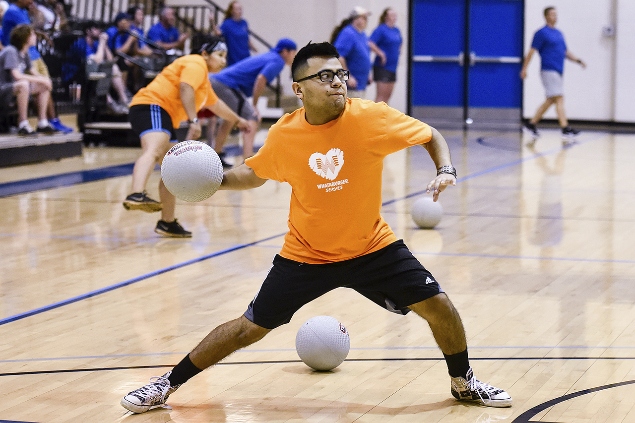 Eliseo Pena prepares to throw a ball during the third annual dodgeball challenge at John Alexander Gym in Jacksonville, Texas, on Monday, June 5, 2017. The dodgeball game kicked off a week of events for the Jacksonville Tomato Festival. (Chelsea Purgahn/Tyler Morning Telegraph)