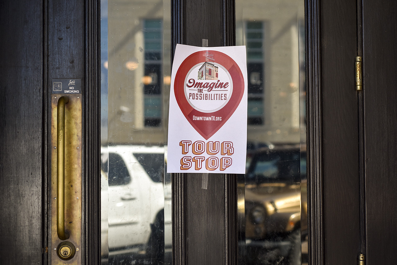 A tour stop sign is seen on a door during the Imagine the Possibilities Tour in downtown Tyler, Texas, on Thursday, May 24, 2017. The self-guided tour was held to correspond with the recent statewide launch of DowntownTX.org and featured historic buildings that are in various stages of residential and commercial remodel. (Chelsea Purgahn/Tyler Morning Telegraph)