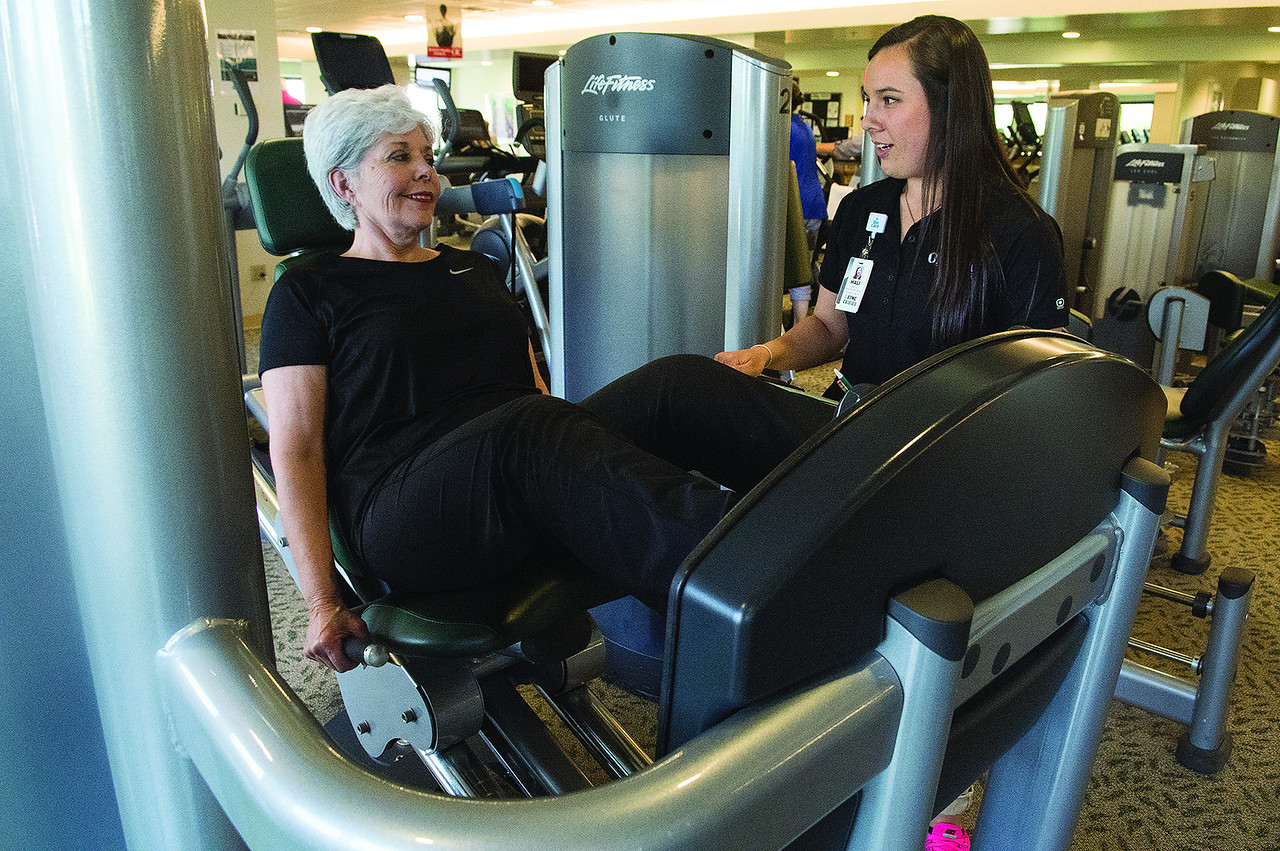 Hali Kizer, coordinator of Exercise is Medicine program visits with program participant Laquita Johnson as she exercises at the ETMC Olympic Center Wednesday May 24, 2017. Participants of the Exercise is Medicine program receive a free two week pass to the ETMC Olympic Center after meeting with a degreed and certified exercise specialist at the ETMC Olympic Center in Tyler for an initial fitness assessment, goal development, and exercise prescription.   (Sarah A. Miller/Tyler Morning Telegraph)