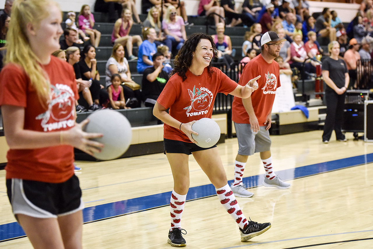 Britian McKinney smiles and points at the opposing team during the third annual dodgeball challenge at John Alexander Gym in Jacksonville, Texas, on Monday, June 5, 2017. The dodgeball game kicked off a week of events for the Jacksonville Tomato Festival. (Chelsea Purgahn/Tyler Morning Telegraph)