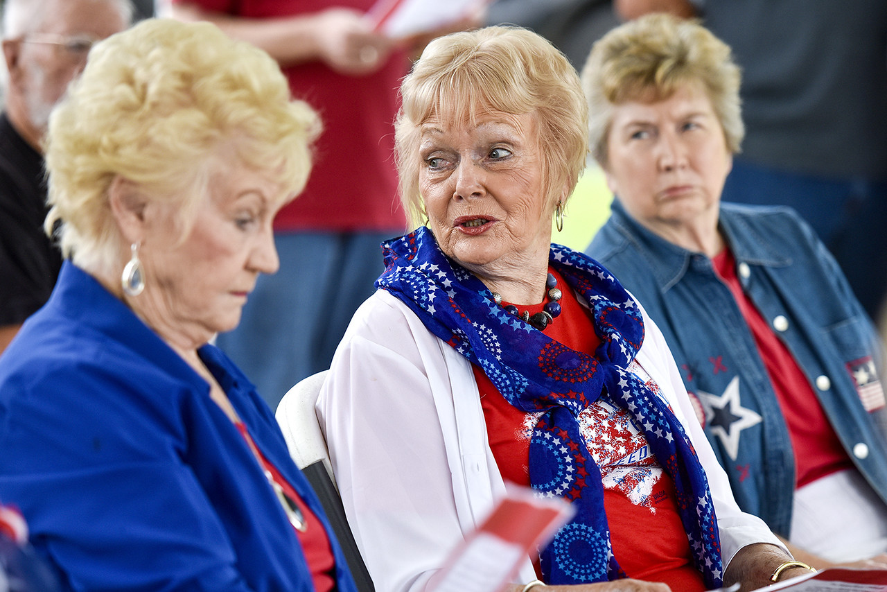 Dorothy McHam, center, looks over her shoulder during the annual Memorial Day flag ceremony at Chandler Memorial Cemetery in Chandler, Texas, on Monday, May 29, 2017. Names of World War I veterans who rest in the cemetery were read and honored. (Chelsea Purgahn/Tyler Morning Telegraph)