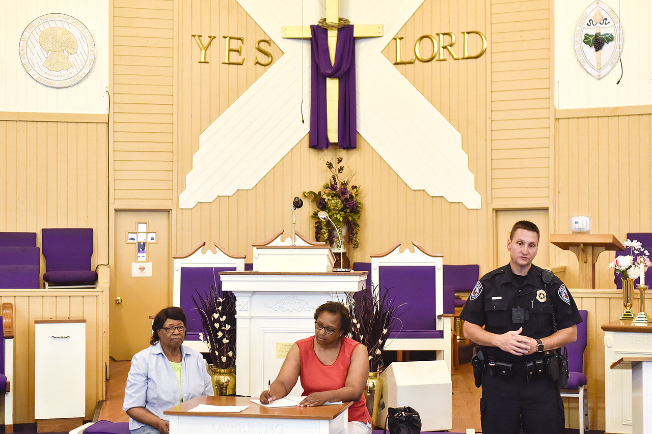 Jerlean Hudson and Pat Record-Henry listen as Officer Darrell Gardner during a community meeting at Smith Temple Church of God in Tyler, Texas, on Tuesday, May 30, 2017. Gardner has worked the same beat for over 18 years. He has established a relationship with the citizens who call him directly when things are not right in their neighborhoods. (Chelsea Purgahn/Tyler Morning Telegraph)