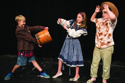 "Luke Petri, Addison Filer, and Jonah Pierce stage a scene from their play ""Ted"" during the Thespians 'N Training theater arts camp held at the Cherokee Civic Theatre in downtown Rusk Wednesday July 26, 2017. The young campers have 40 hours to audition, rehearse, organize costumes and props and build sets to produce a one-act show. The plays will be performed for the public July 29.  (Sarah A. Miller/Tyler Morning Telegraph)"