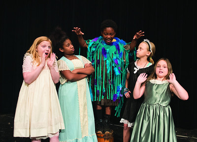 Jordyn Herring, 9, Estebiana Arrington, 11, Elijah Francis, 11,  Katie Petri, 10, and Hailey Gray stage a scene from their play during the Thespians 'N Training theater arts camp held at the Cherokee Civic Theatre in downtown Rusk Wednesday July 26, 2017. The young campers have 40 hours to audition, rehearse, organize costumes and props and build sets to produce a one-act show. The plays will be performed for the public July 29.  (Sarah A. Miller/Tyler Morning Telegraph)