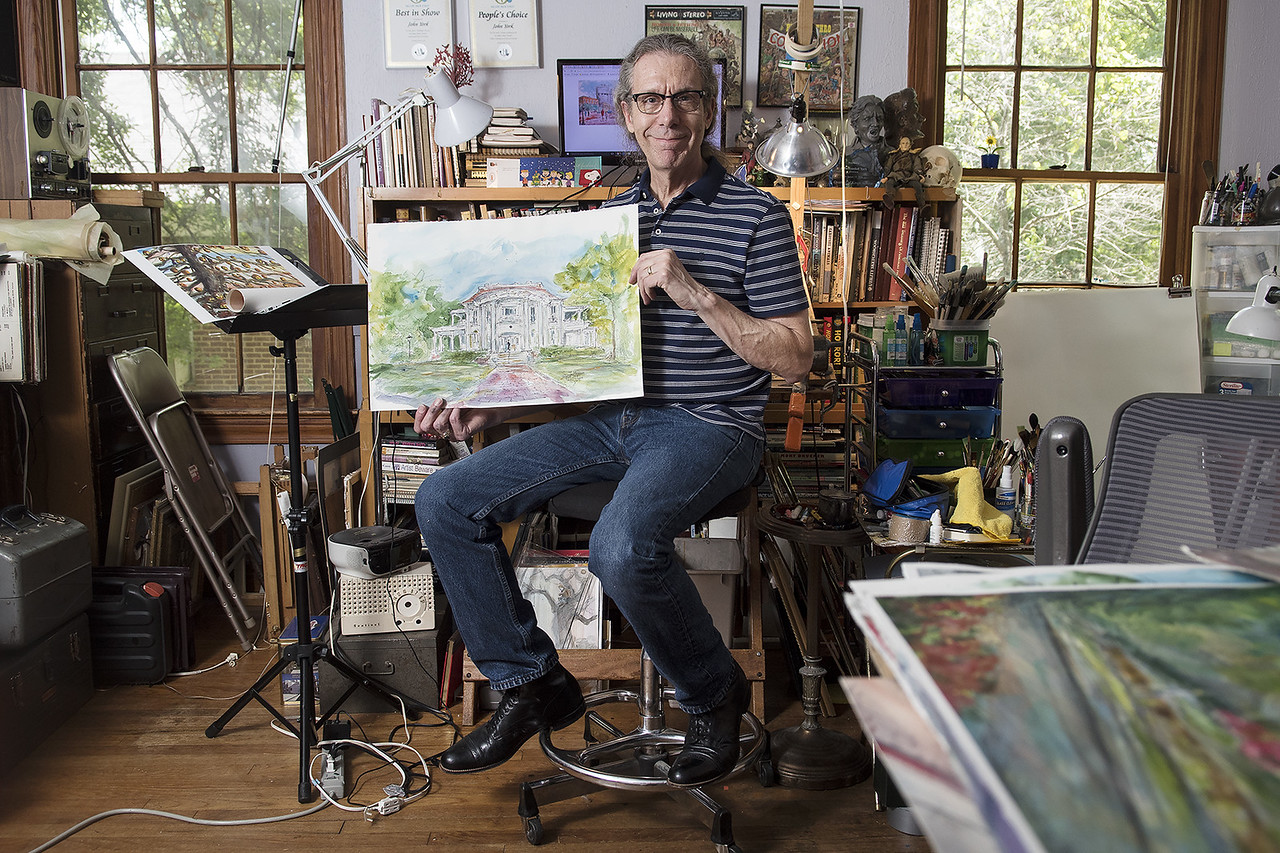 Artist John Randall York holds his watercolor painting of the Goodman Museum at his home studio in Tyler Tuesday May 23, 2017. York started depicting scenes of downtown Tyler last year.  (Sarah A. Miller/Tyler Morning Telegraph)