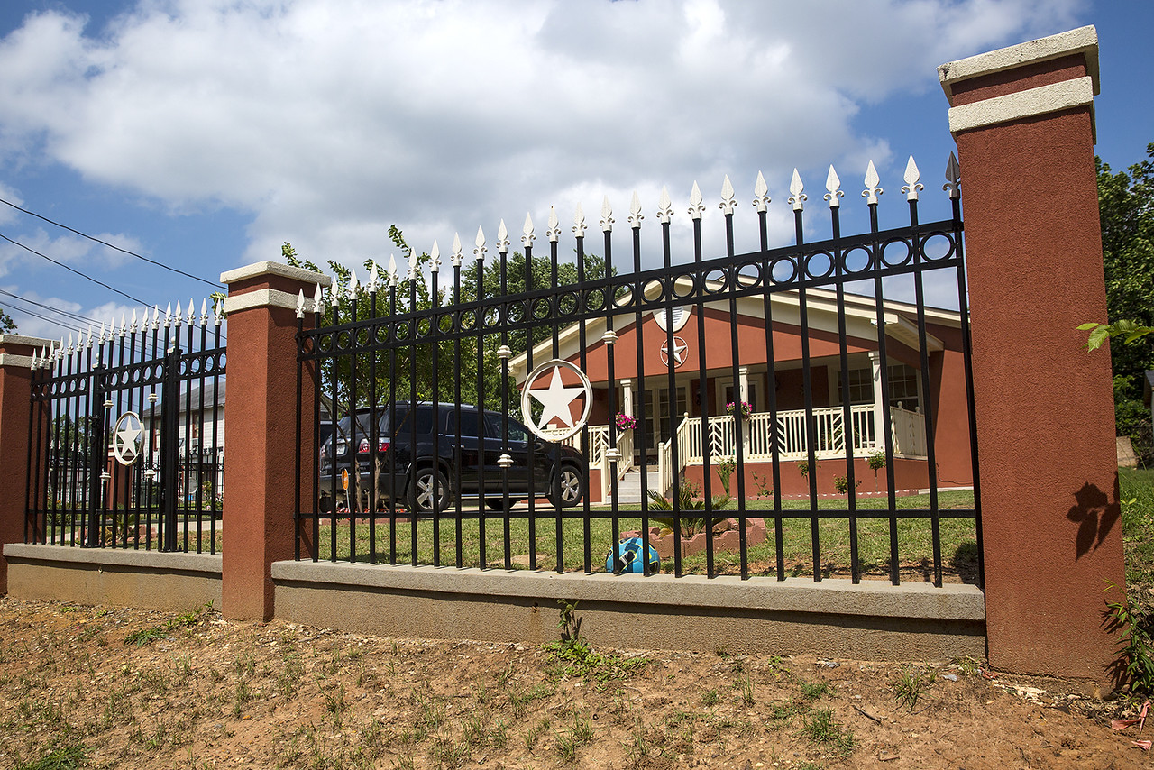 The Arellano family's fence, photographed in Tyler, Texas, on Friday, May 26, 2017. Tyler residents currently have to go through a special permitting process for front yard fences, and Tyler City Council is looking at this permit process again. Lomeli Arellano was the last person to gain approval from the city for a front yard fence. (Chelsea Purgahn/Tyler Morning Telegraph)