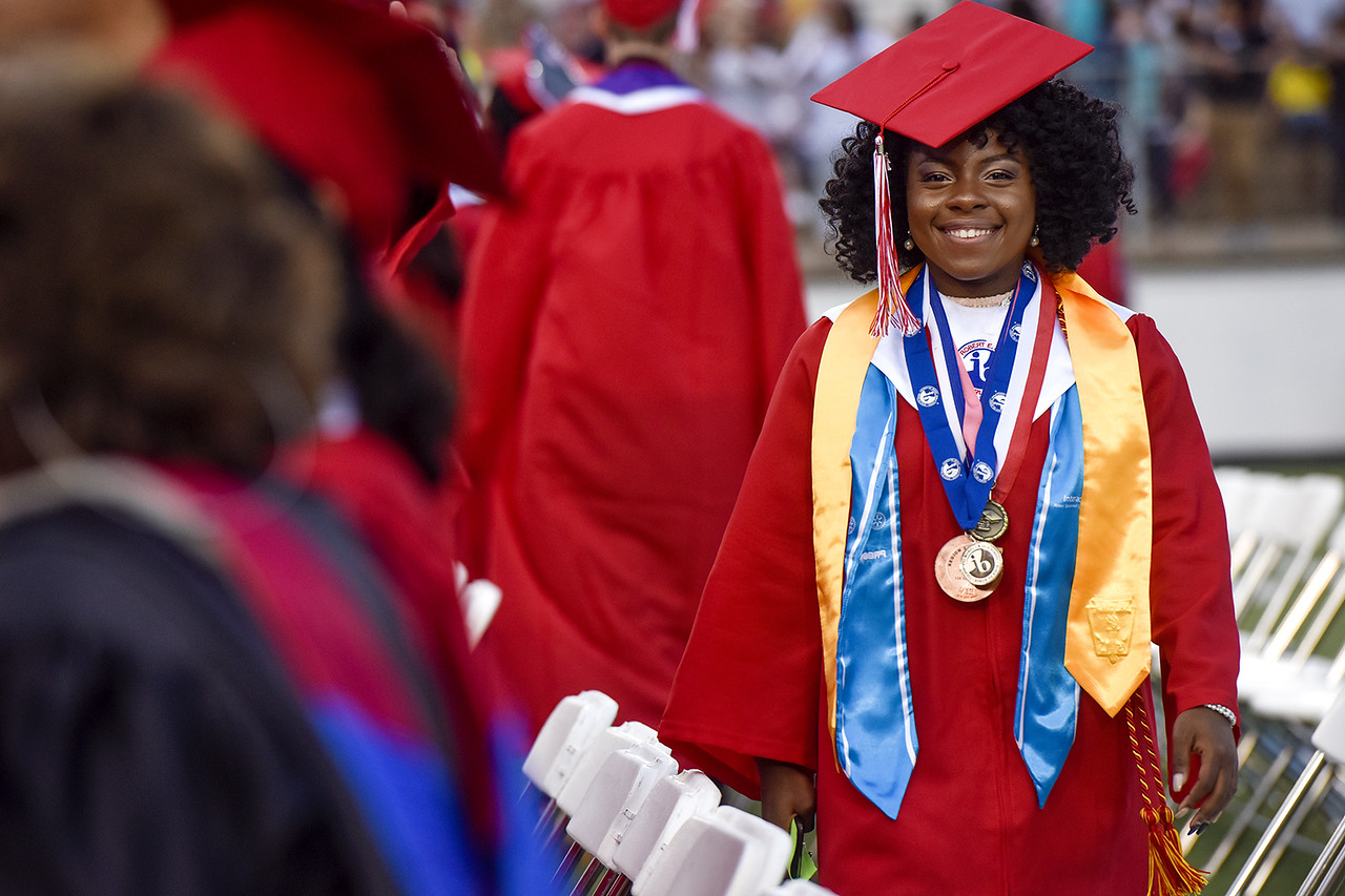 Venisha Harmon walks to her seat during Robert E. Lee High School's graduation ceremony at Trinity Mother Frances Rose Stadium in Tyler, Texas, on Friday, June 2, 2017. Thousands of friends and family members came to see the hundreds of seniors walk the stage for graduation. (Chelsea Purgahn/Tyler Morning Telegraph)