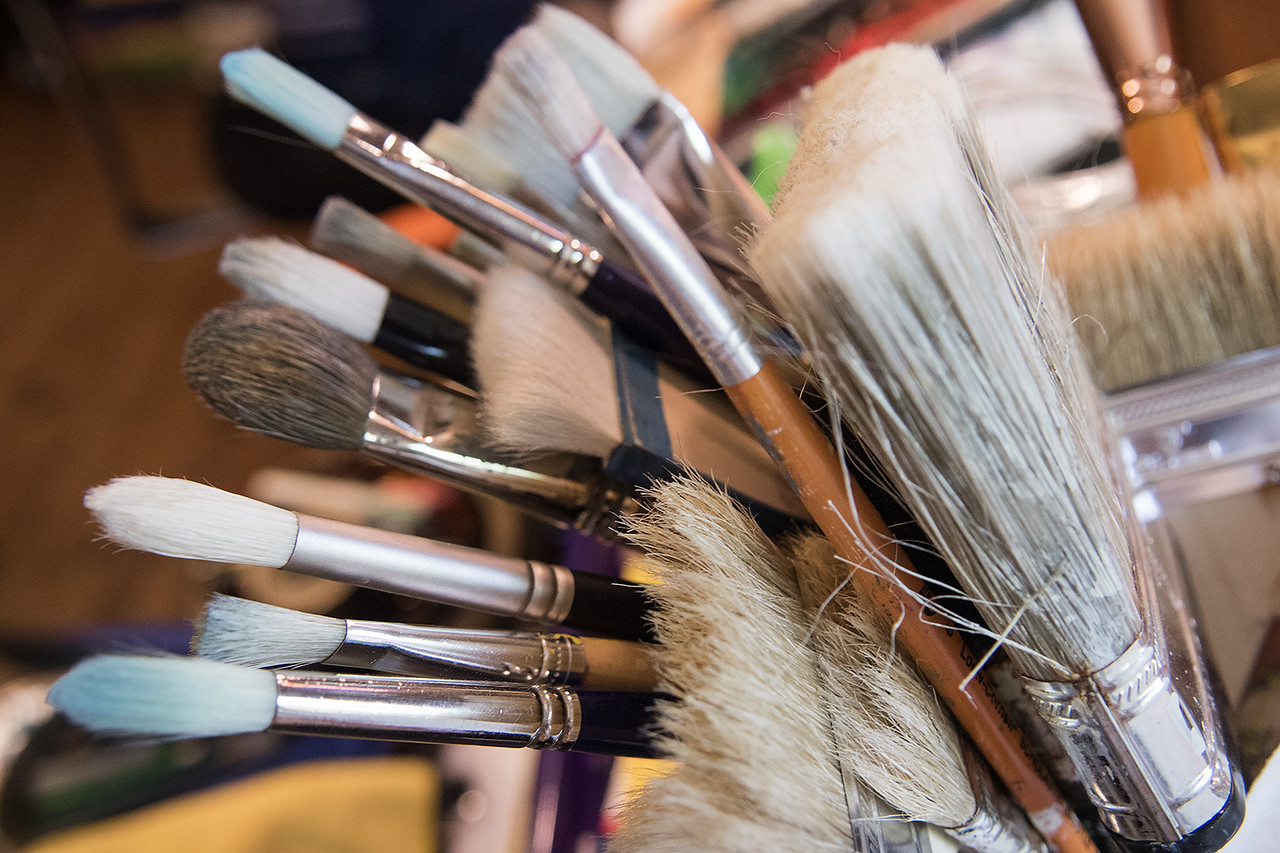 Artist John Randall York's paintbrushes are pictured at his home studio Tuesday May 23, 2017.   (Sarah A. Miller/Tyler Morning Telegraph)