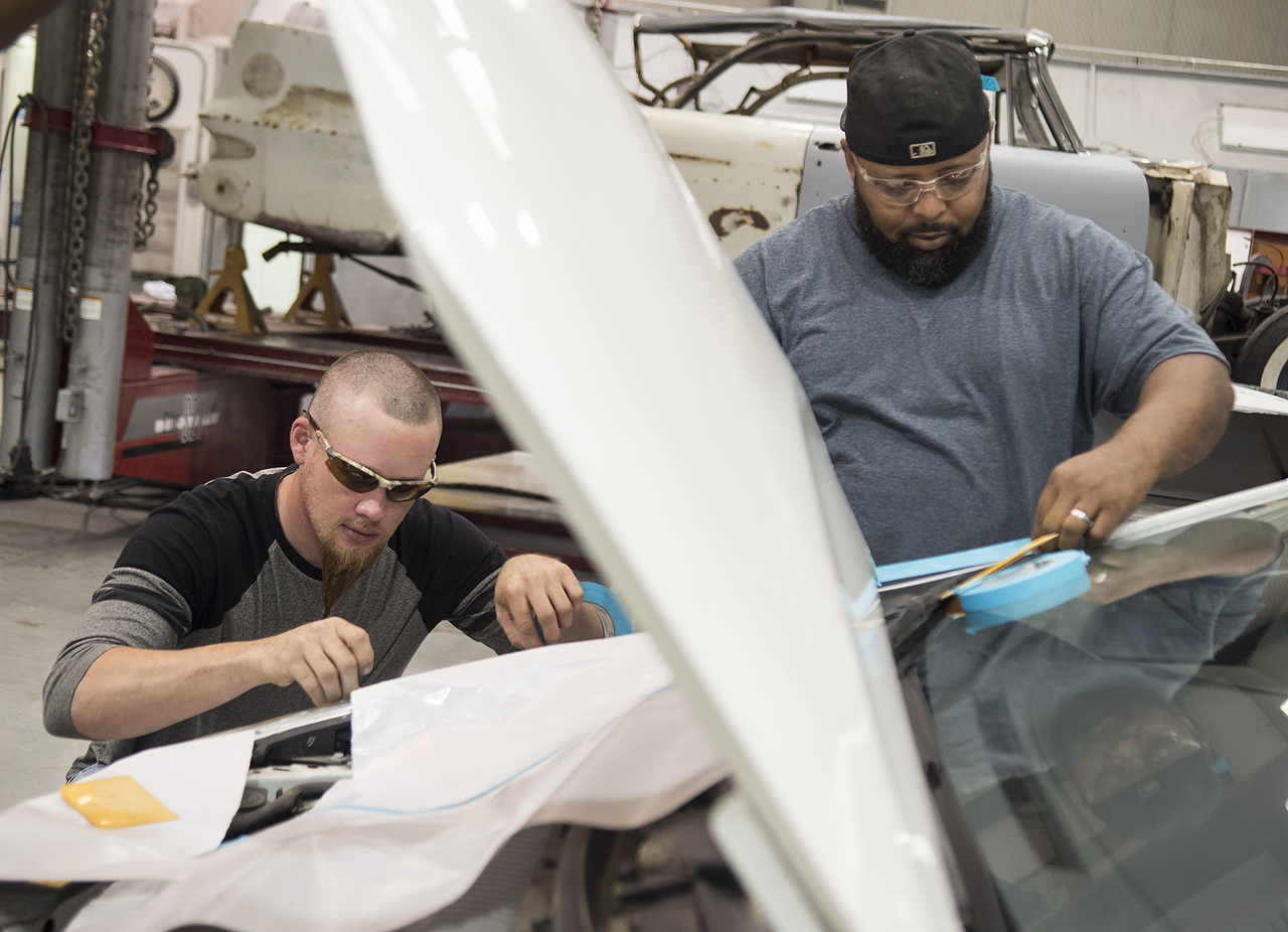 Nate Williams and Bronte Elder mask off a Toyota Prius as prep for primer application during class at Kilgore College's auto body shop  Monday May 17, 2017.  (Sarah A. Miller/Tyler Morning Telegraph)